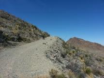 Me pushing my bike up Christmas Mountain.
